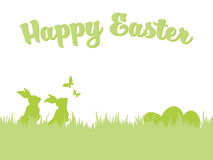 Easter background with easter bunnies, eggs and butterflies. Happy Easter greeting card template. Silhouettes of Easter bunnies and eggs in grass with flying Stock Photography