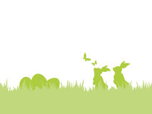 Easter background with easter bunnies, eggs and butterflies. Happy Easter background. Silhouettes of Easter bunnies and eggs in grass with flying butterflies Royalty Free Stock Image