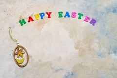 Easter background. Easter decoration and colorful letters forming words HAPPY EASTER. Copy space for your text. Flat lay of Easter celebration concept stock photo