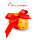 Easter background  Easter egg with red gift bow Stock Photos