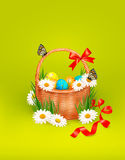 Easter background with Easter eggs in basket and b Stock Images