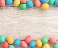 Easter background with Easter eggs. And spring flowers. Top view with copy space Stock Photography
