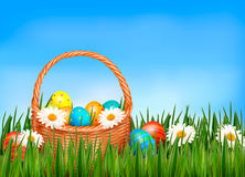Easter background. Easter eggs and flower with basket Stock Photo