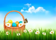 Easter background. Easter eggs and flowers in a ba Stock Images