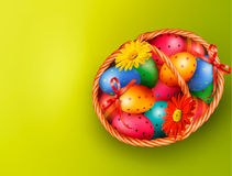 Easter background with Easter eggs and flowers wit Stock Photos