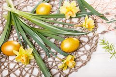 Easter background with Easter eggs and spring flowers. Top view with copy space. Easter background with Easter eggs, pussy-willow and spring flowers narcissus stock image