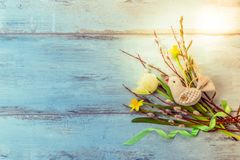 Easter background with Easter eggs and spring flowers. Top view with copy space. Easter background with Easter eggs, pussy-willow and spring flowers tulips. Top stock photos