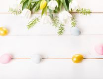 Easter background with Easter eggs and spring flowers. Top view with copy space. Easter background with Easter eggs, pussy-willow and spring flowers yellow stock photo