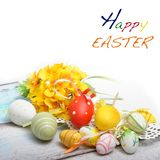 Easter background with Easter eggs and spring flowers Stock Photo