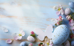 Easter background with Easter eggs and spring flowers. Top view Stock Image