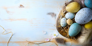 Easter background with Easter eggs and spring flowers. Top view royalty free stock photography