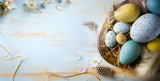 Easter background with Easter eggs and spring flowers. Top view stock photos