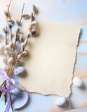 Easter background with Easter eggs and spring flowers. Top view Royalty Free Stock Image