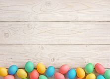 Easter background with Easter eggs. And spring flowers. Top view with copy space Royalty Free Stock Photos