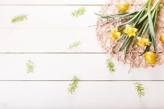 Easter background with Easter eggs and spring flowers. Top view with copy space. Easter background with Easter eggs, pussy-willow and spring flowers narcissus stock photo