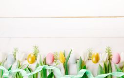Easter background with Easter eggs and spring flowers. Top view with copy space. Easter background with Easter eggs, pussy-willow and spring flowers yellow stock photos