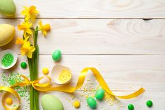 Easter Background with Easter Eggs and Spring Flowers Stock Photos