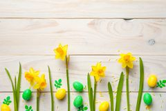 Easter Background with Easter Eggs and Spring Flowers Royalty Free Stock Images
