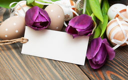 Easter background with easter eggs and tulips Royalty Free Stock Image