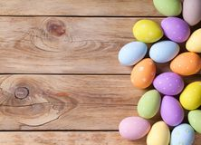 Easter Background with Easter Eggs. On wooden table. Top view. Copy space royalty free stock images