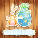Easter background with egg, bunny and copy space Stock Images