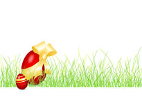 Easter background with egg in the grass Stock Photos