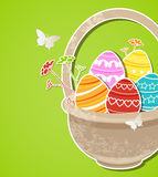 Easter background with eggs in basket Stock Photos