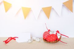 Easter background with eggs in bird nest and empty gift tag sign for Happy Easter greeting message.  royalty free stock images
