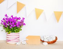 Easter background with eggs in bird nest and empty gift tag sign for Happy Easter greeting message.  stock photography