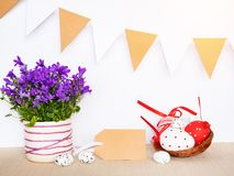 Easter background with eggs in bird nest and empty gift tag sign for Happy Easter greeting message.  royalty free stock photos