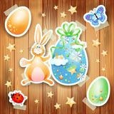 Easter background with eggs, bunny and paper elements Stock Photography