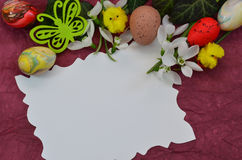 Easter Background with eggs buterfly and snowdrop flowers. Easter composition on burgundy background with eggs , buterfly and snowdrop flowers royalty free stock photo