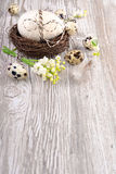 Easter background with eggs and flowers on wood, text space. Easter background with natural eggs and lily of the valley flowers on wooden table, space for your Royalty Free Stock Image