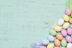 Easter. Background with eggs and plumage Royalty Free Stock Photo