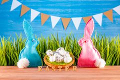 Easter background with eggs, rabbits and green grass royalty free stock photos