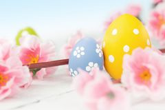 Easter background with Easter eggs and spring flowers royalty free stock photography