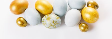Easter background with Easter eggs and spring flowers. Top view with copy space. Easter background, banner with Easter eggs on white. Top view, flat lay stock photo