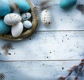 Easter background with Easter eggs on white table royalty free stock photo