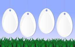 Easter background with four white eggs. Easter background with green grass, blue sky and four white eggs Royalty Free Stock Photography