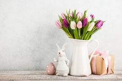 Easter background. Fresh tulips and easter decorations royalty free stock images