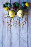 Easter background. Funny easter eggs painted yellow on color background. Easter holiday concept. royalty free stock photo