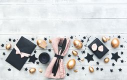 Easter background. gold eggs over wooden table stock image