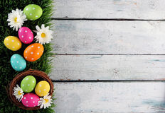 Easter background with grass. Easter eggs on wood backgrpund Stock Photography
