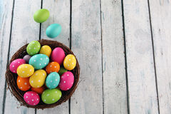 Easter background with grass. Easter eggs on wood backgrpund Royalty Free Stock Photo