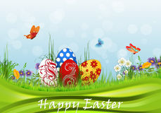 Easter background. Green meadow with Easter eggs Stock Images