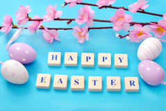Easter background with greetings and blooming tree branch Royalty Free Stock Photo
