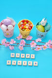 Easter background with greetings and eggs in buckets Stock Image