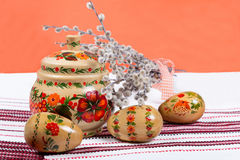 Easter background with hand painted eggs and pussy-willow Stock Photos