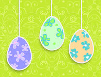 Easter background with hanging on the ropes eggs Royalty Free Stock Photos