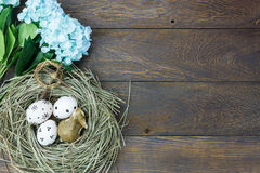 Easter background.Happy easter eggs pained also rabbin. Top view easter background.Happy easter eggs pained also rabbin and cross on nest.Texture rustic wooden Stock Photo